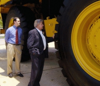 Ralph Klein tests the tires on a new Caterpillar 777F off-road truck in front of the Smithsonian building in Washington, D.C. Photo: Washington Post, via Sqwalk.com.