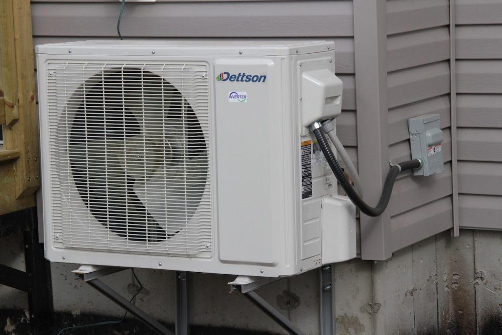 * Heat pump on residential building