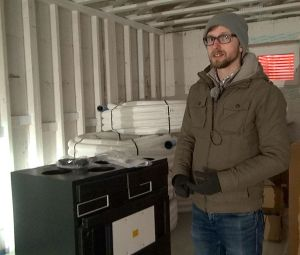 * Michael Nemeth with the 93% efficient heat recovery ventilator. Photo David Dodge, GreenEnergyFutures.ca