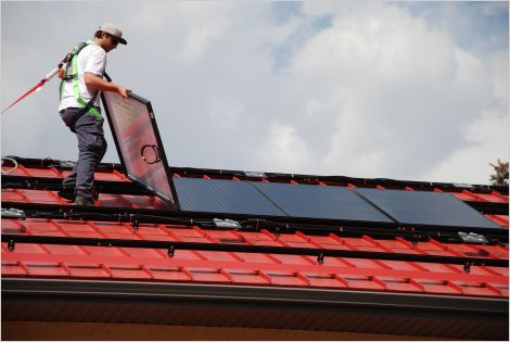 Solar PV installer works on roof