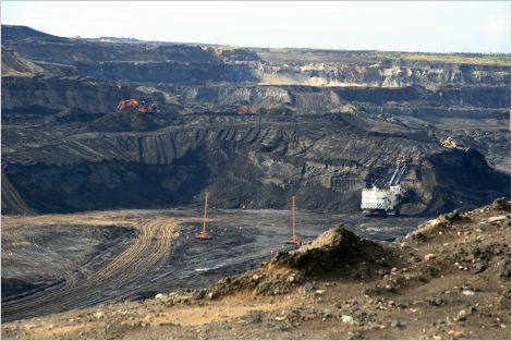 Oilsands mine with equipment